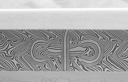 Ukázka vzoru na damaskované čepeli vyrobené Patrickem Bártou