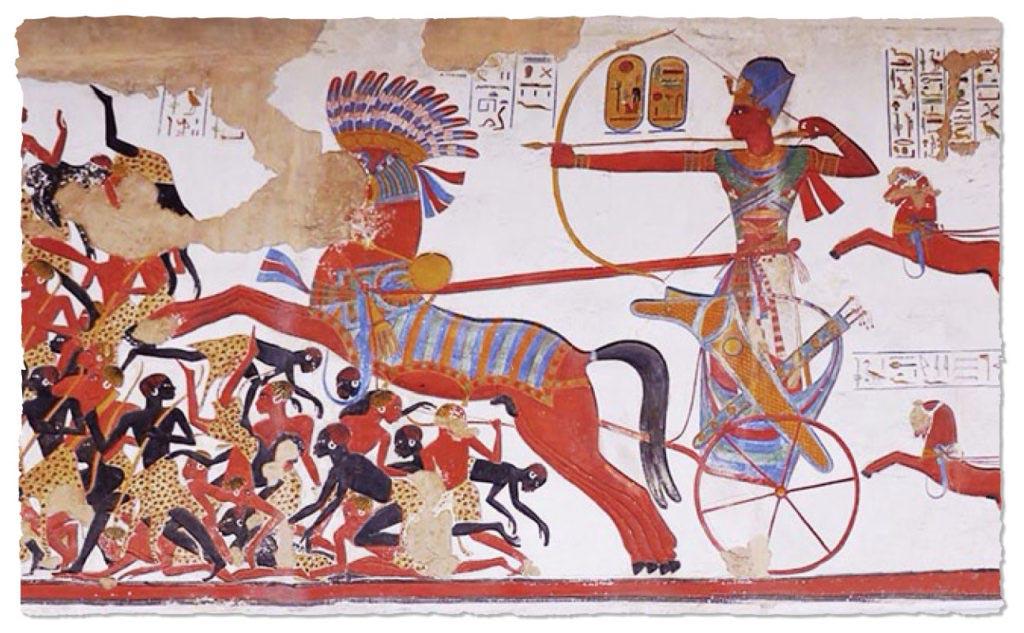 Faraón Ramesse II. na výpravě proti Núbii. Panovník řídí svůj vůz pomocí otěží uvázaných kolem pasu jako akrobat